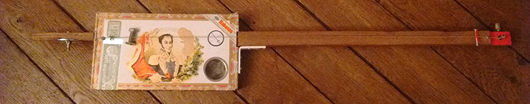 Handcraft cigar box guitar made by One String Is Enough for The Hummingbirds Project